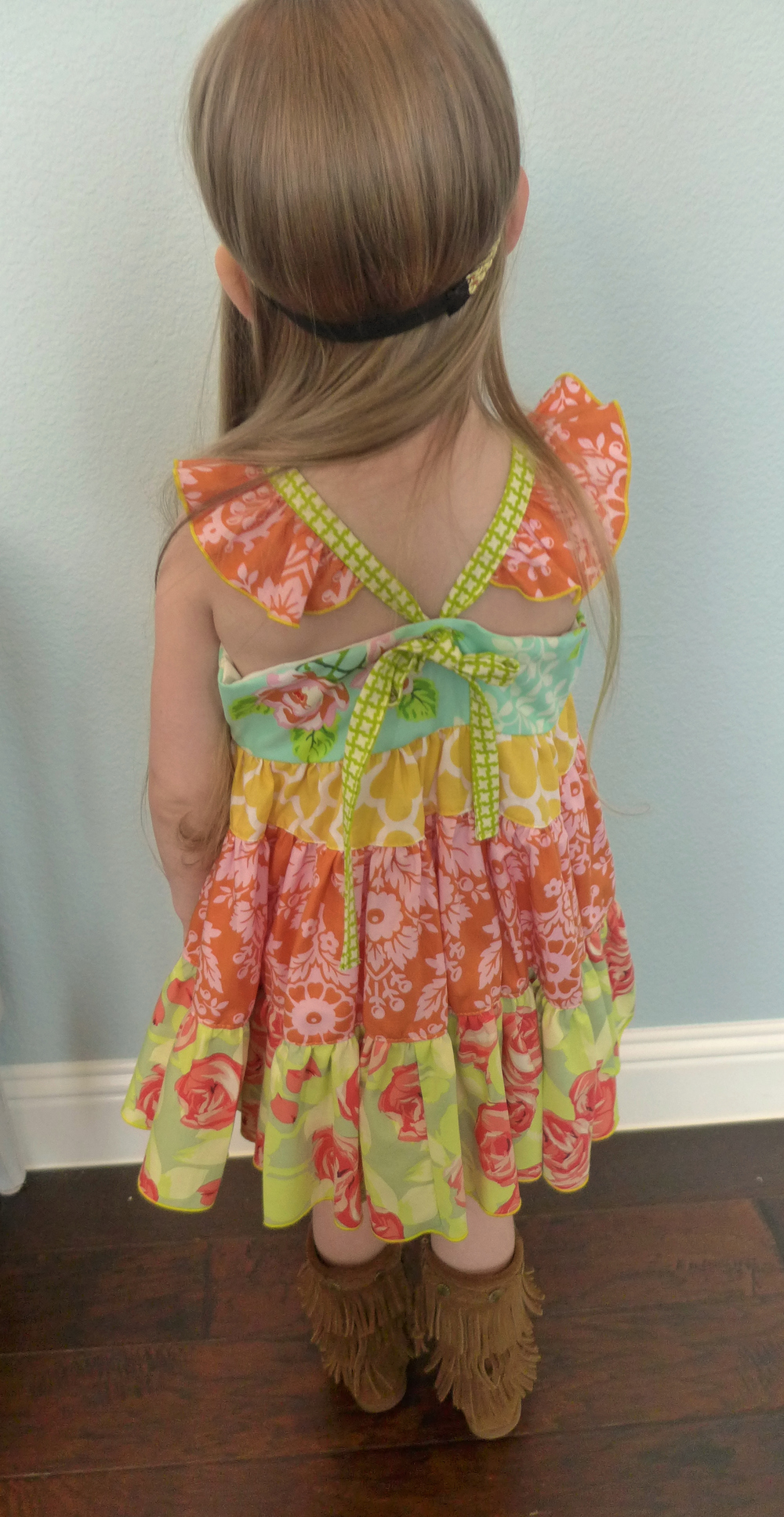 Adorable flutter sleeves and back tie details