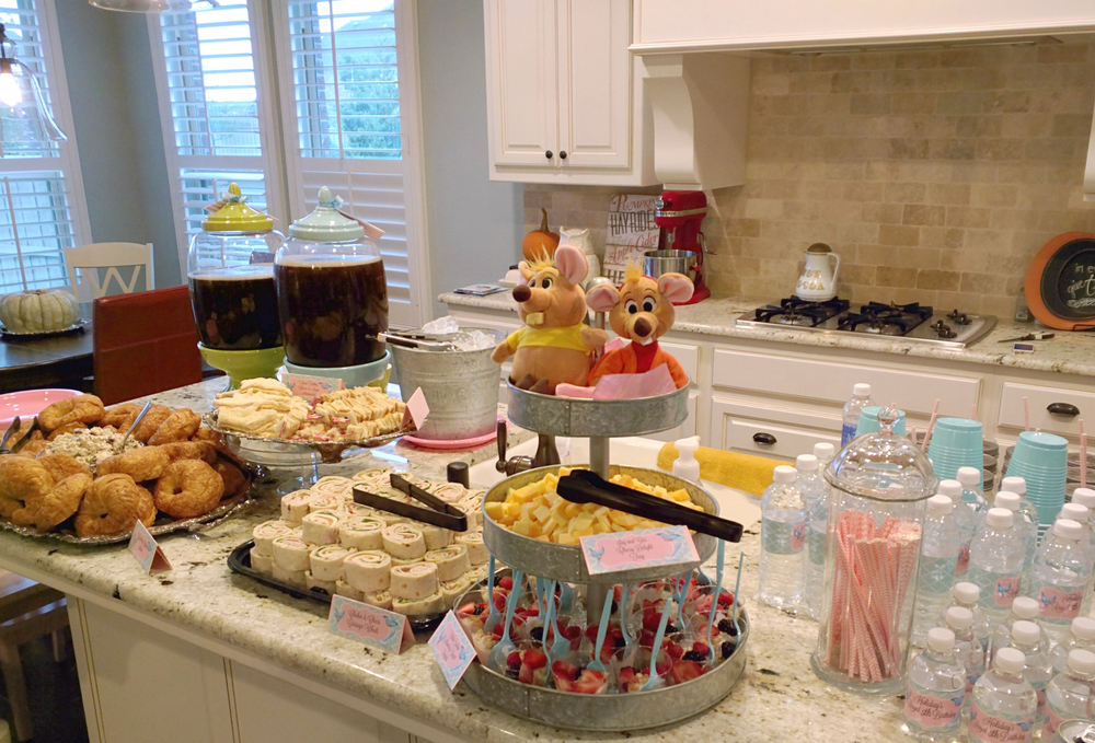 """I SO wanted the girls to have their own little buffet set-up in the """"Ballroom,"""" but I just couldn't fit it all in there! I kept it pretty simple with Croissants, Sonoma Chicken Salad, Turkey and Cheese Tiara Cut-Out Sandwiches, PB&J Fairy Wand Sandwiches, """"Carriage Wheels"""" Rollups, Jaq and Gus Cheese Tray & Berry Yogurt Parfaits. I gave them all cute, princessy names and made little buffet cards for each."""