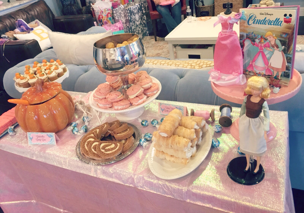 Another little dessert spread in the living room.  In retrospect, this whole set-up was probably unnecessary but the Cinderella Trail Mix (inside the pumpkin) was a pretty big hit, as were the cream puffs in the silver bowl!!!