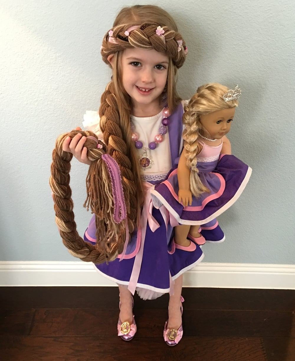 Amazing hair (it's made out of yarn and has a stretch for a perfect, comfortable fit), Rapunzel apron and matching doll apron by Ross and Rosie Designs!