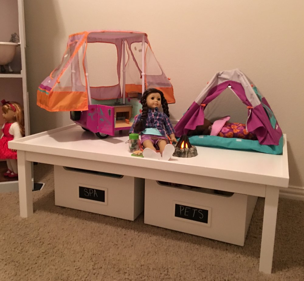 Y'all know I'm OBSESSED with the Carolina Activity Table and Carts from Pottery Barn Kids.  It's SO super useful for doll play so whatever Holiday is really focused on can be elevated and set apart to a great play height.  In the left cart is all of her American Girl Spa accessories while the right bin houses all of her AG pets and their accessories.