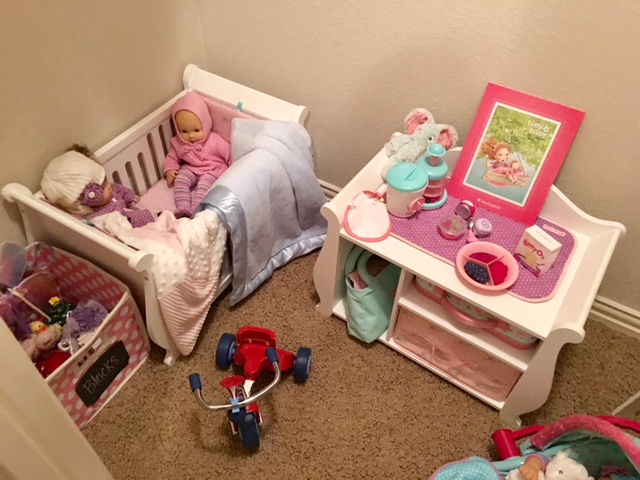 Bitty Baby's Toy Box is on the far right.  Retired Bitty Baby crib (though the current Bitty Baby cradle available is darling).  Bitty Baby's Changing Table in the center.