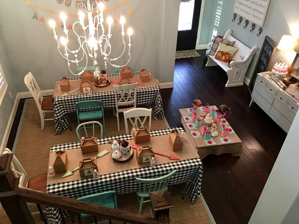 Here you can see our dining room set up along with the doll table. The buffet on the right is set with cake, cookies and bottled extra bottles of water!