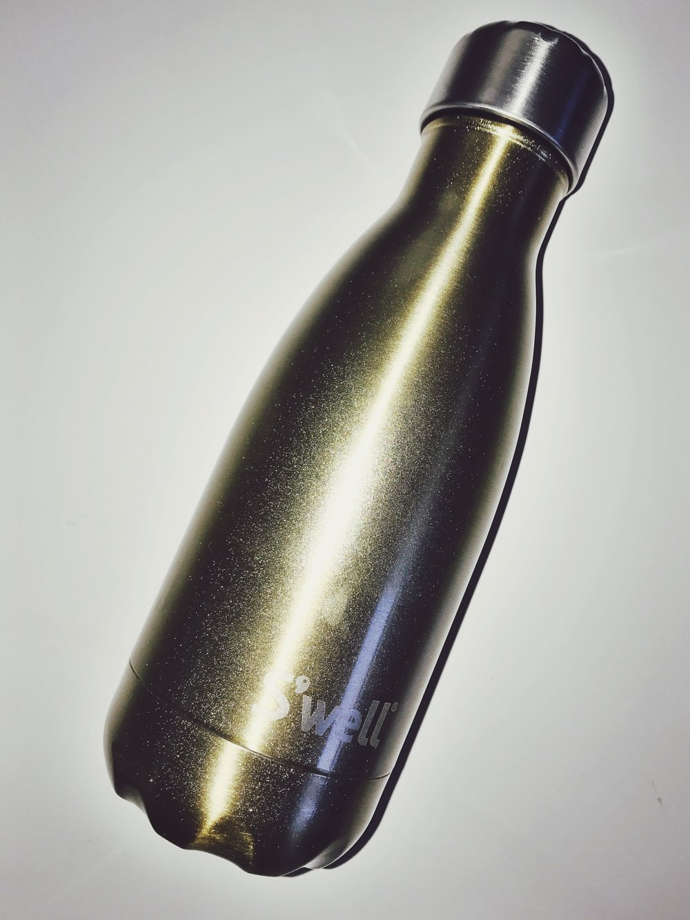 s'well bottle - A signifier of fancy wellness taste! I almost did not buy this because I think carrying around water is idiotic. But then I found out this bottle could keep hot items hot for an extended period of time and I relented. Coffee is very reasonable to carry around, after all.