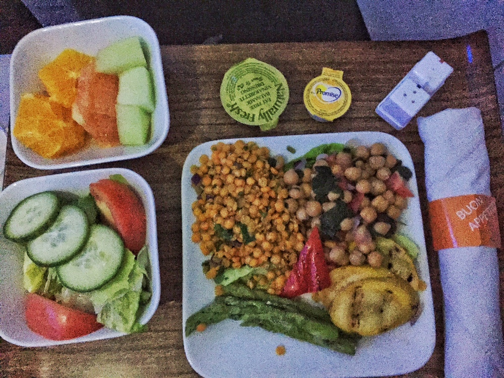 Mini salad with cucumbers and tomatoes sliced oranges, honeydew and grapefruit Vegetable platter with chickpea salad, curried lentils, roasted yellow squash and asparagus