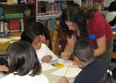 Elizabeth working with Hoover students