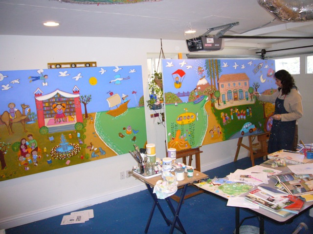 The mural is painted using acrylics on two large boards. Here I am working on it in my studio...