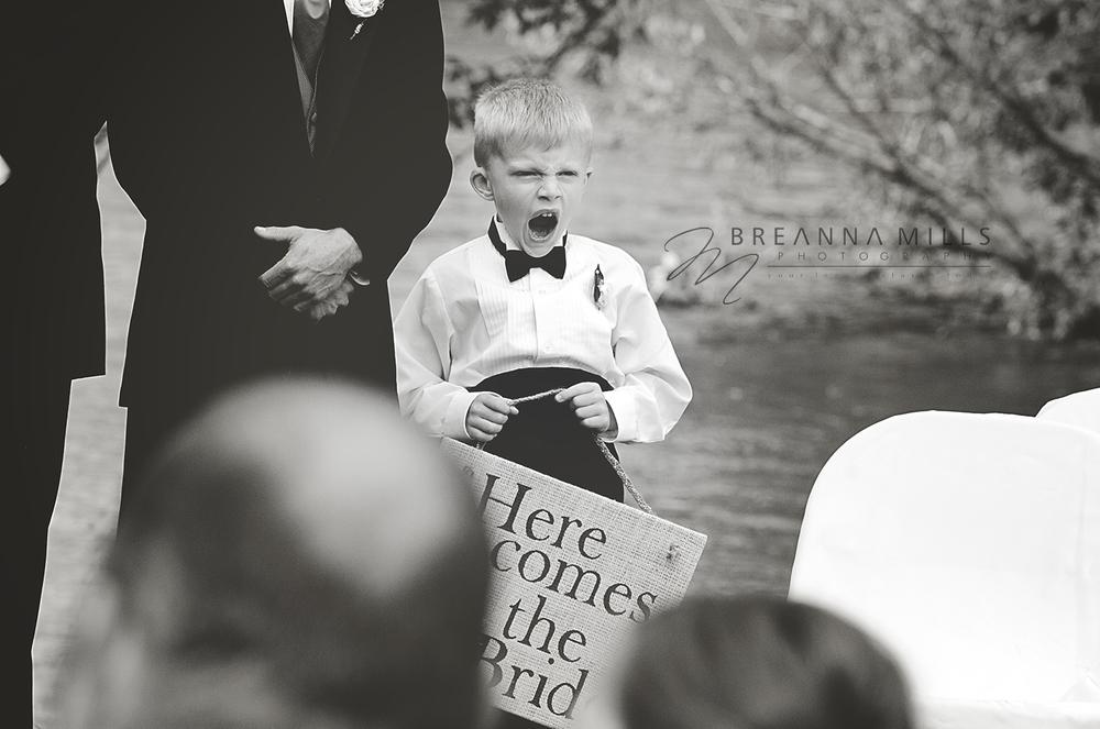 Johnson City wedding photographer, Breanna Mills Photography captures ring bearer at wedding ceremony.