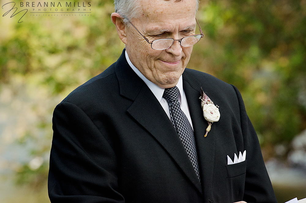 Johnson City Wedding Photographer, Breanna Mills Photography captured the minister on bride and groom's wedding day.