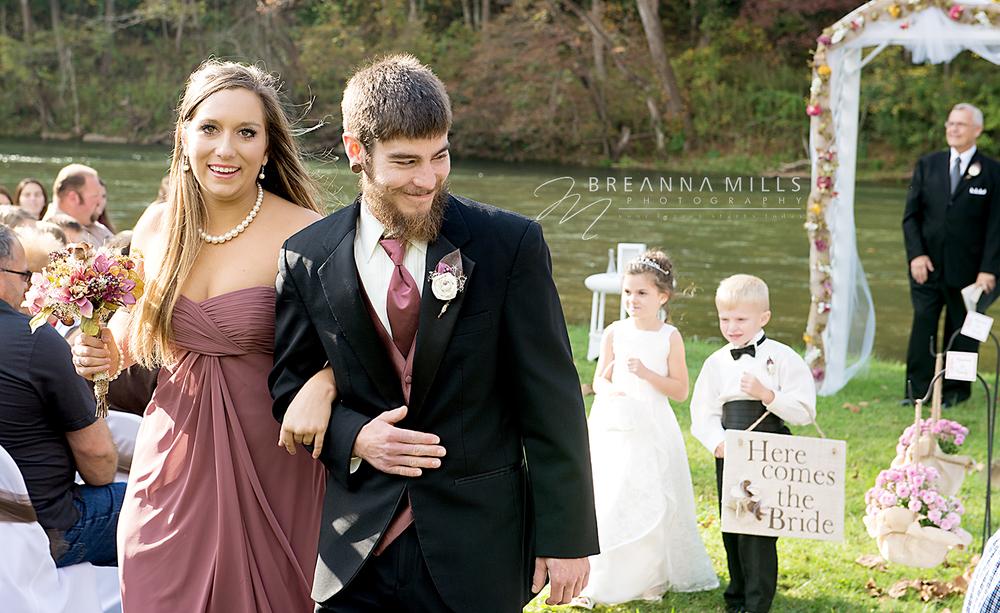 Johnson City wedding photographer, Breanna Mills Photography captured bridesmaid and groomsman during wedding ceremony.