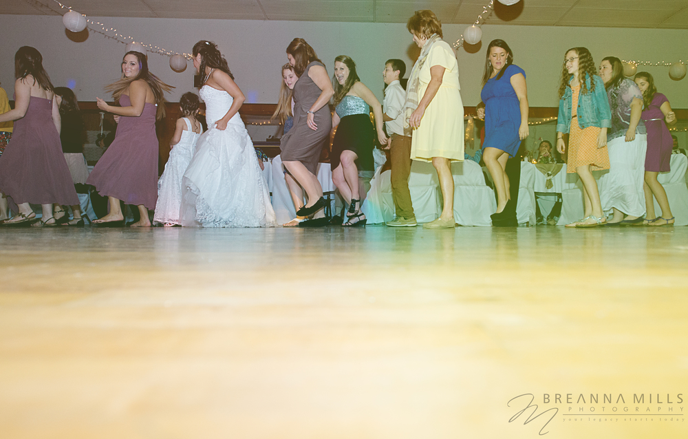 Johnson City Wedding Photographer, Breanna Mills Photography  captures dancing at wedding reception.