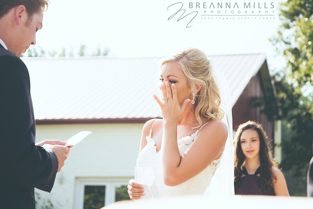 Bride gets emotional exchanging vows with her groom on her wedding day at the Corey Ippolito Winery wedding venue.