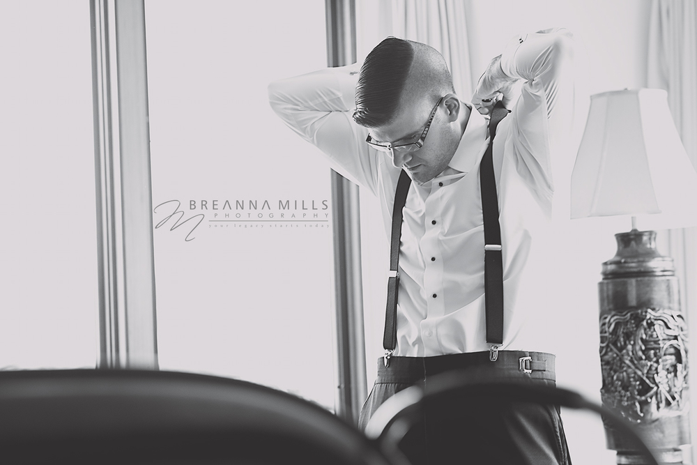 Johnson City Wedding Photographer Breanna Mills Photography captures a groomsman preparing for the wedding ceremony at Storybrook Farm in Johnson City, TN.