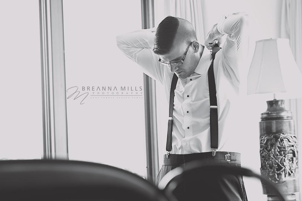 Johnson City Wedding Photographer Breanna Mills Photography captures a groomsman preparing for the wedding ceremony at Storybrook Farm in Johnson City, TN.