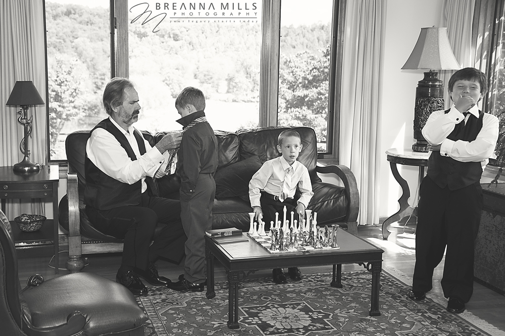 Johnson City, TN wedding photographer Breanna Mills Photography captures a grandfather helping his grandchildren prepare for the wedding ceremony at Storybrook Farm in Johnson City, TN.