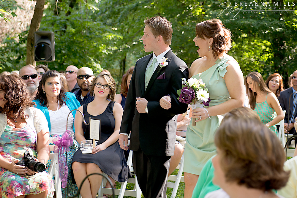 Johnson City wedding photographer, Breanna Mills Photography captures a bridesmaid and groomsman during the wedding ceremony at the outdoor wedding at Storybrook Farm wedding venue.
