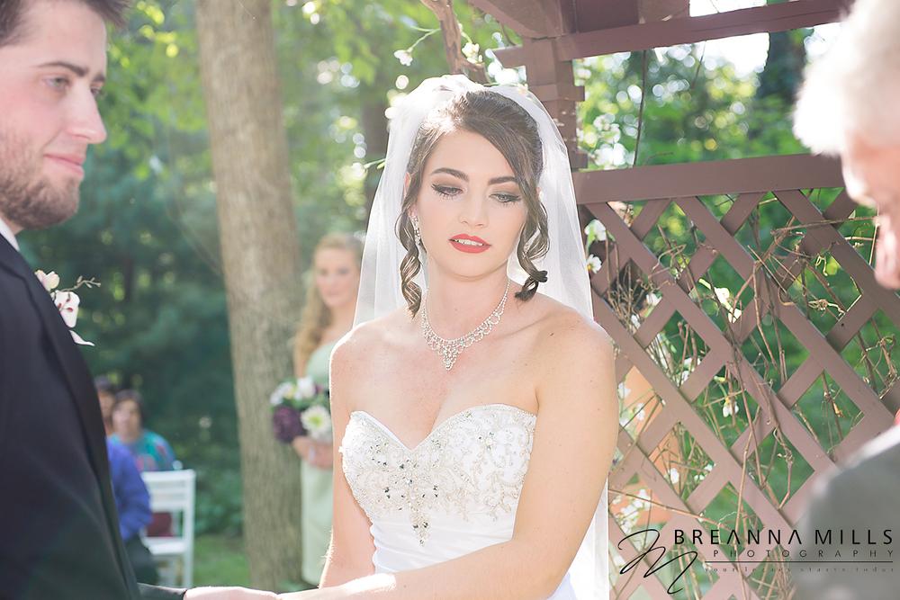 Johnson City, TN wedding photographer Breanna Mills Photography photographs a bride during her outdoor wedding ceremony at Storybrook Farm wedding venue.