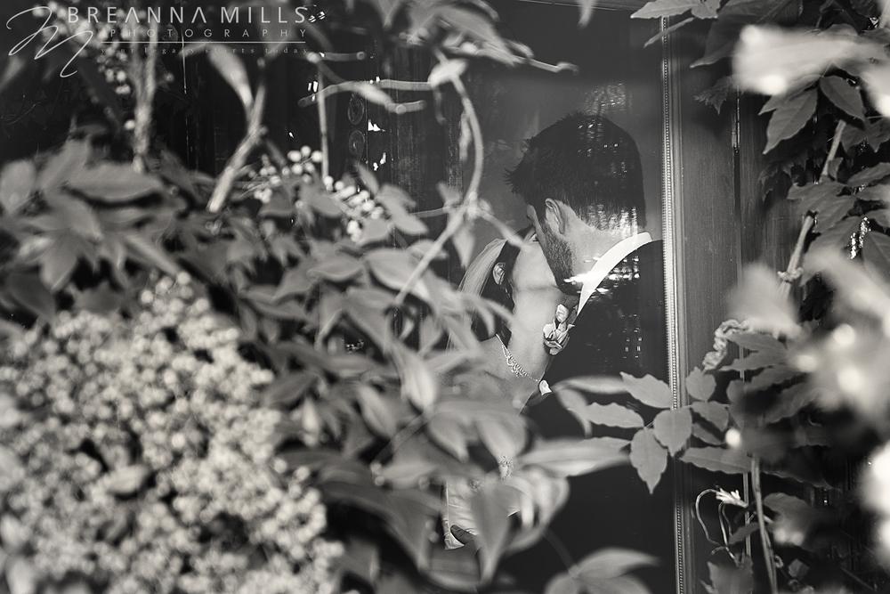 Johnson City, TN wedding photographer, Breanna Mills Photography shoots creative images of bride and groom on their wedding day at Storybrook Farm wedding venue.