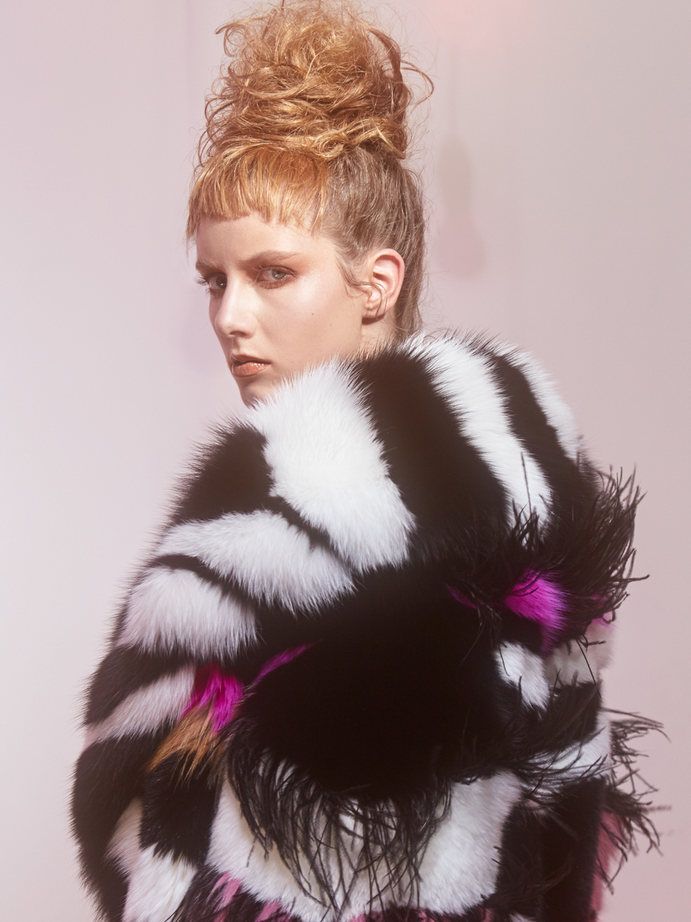 Eddie Coat:  Saga Furs ™  fox and mink with ostrich feather inserts, 100% silk charmeuse lining.