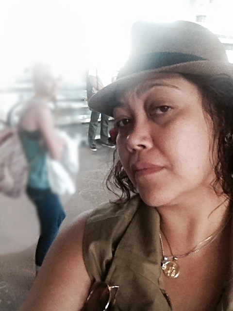 My stank face in the Denver airport, and a photo bomber.