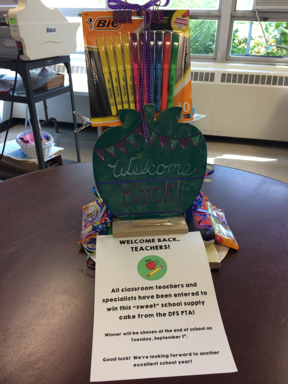 "September 19, 2015:  The DFS PTA board members hosted their annual ""Welcome Back"" breakfast for teachers and staff on the first day of school. In addition to the breakfast, all teachers and staff were entered to win this ""sweet"" school supply cake, chock-full of great supplies and little extras. This year's winner was our new 4th grade teacher, Mrs. Potok!  Congratulations!"