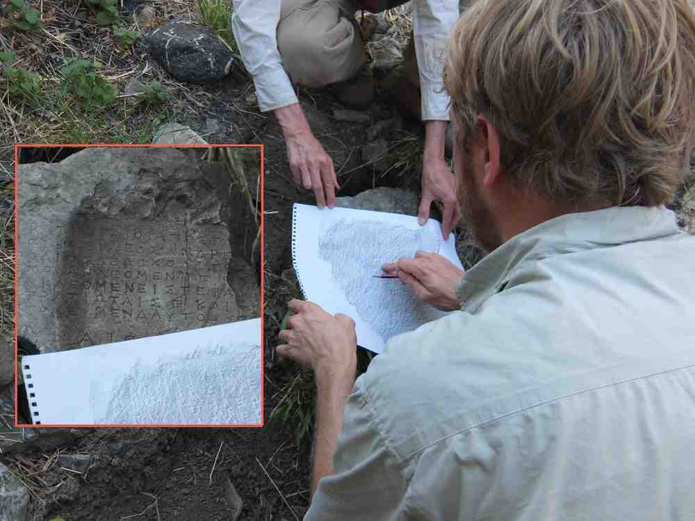 Making a rubbing of an ancient inscription on a stone tablet