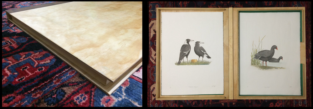 The folio closed and then opened with the 'Magpie' and 'Dusky Moorhen' prints displayed