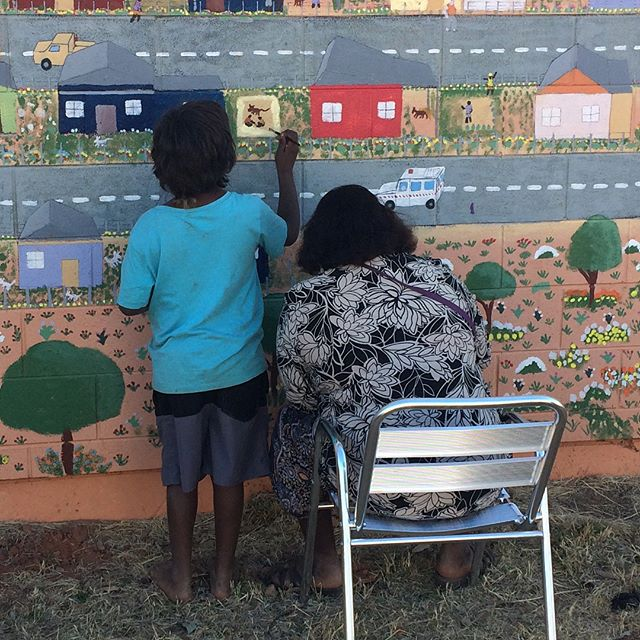 During the last week I've been helping facilitate a huge mural on the front of the Tapatjatjaka Art Centre in Titjikala. The mural depicts the small and remote Northern Territory community and elements of the surrounding landscape. It has been painted by  local artists, school children, and anyone else in the community who's interested in being involved. So far this week we've had painters ranging in age from 5 to 80 years old, all working together. It's a great communal project and opportunity for locals to paint the places and activities that are important to them. The mural has been advancing on and off since we started painting it in 2014, It's about 20m long and the plan is to have it constantly evolving and reacting to changes in the community. #mural #painting #community #art #titjikala #titjikalaartcentre