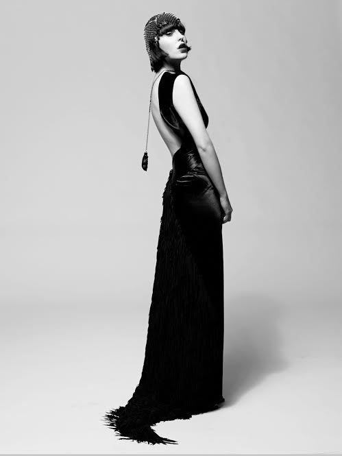 A floor-length backless dress, designed by Miss Tosh