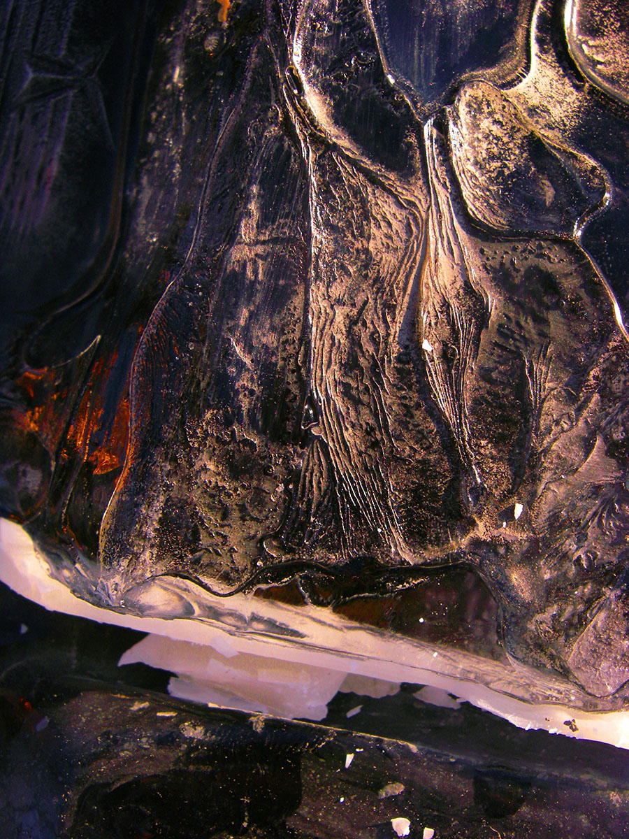 torched lake ice with copper reflection. 2012