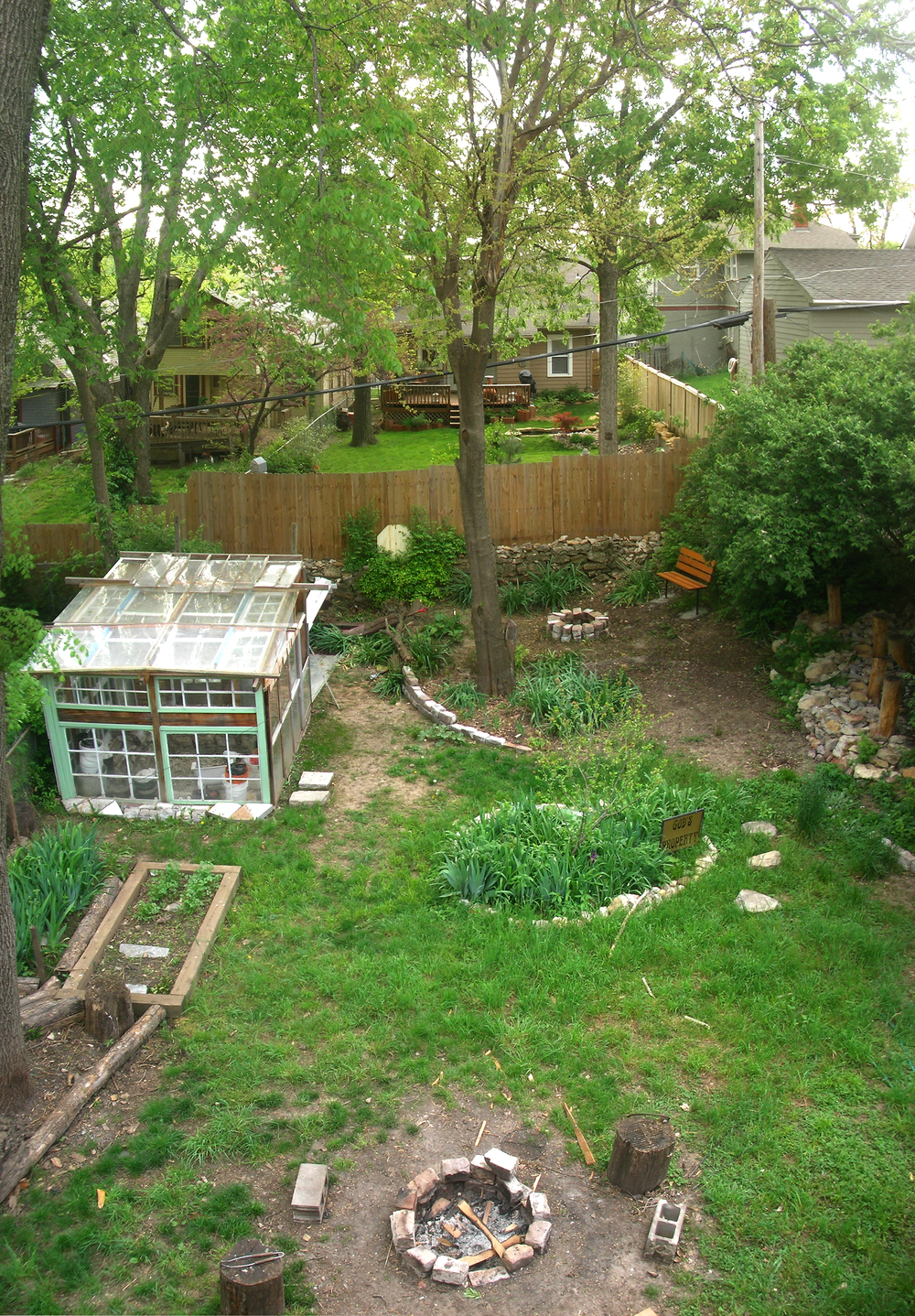 Greenhouse and landscaping from Kansas City bungalow remodel.