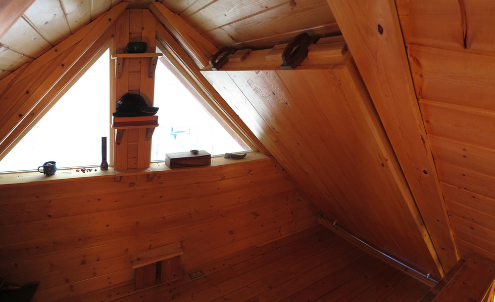 Murphy Bed in Cabin Loft. Sitka Spruce, with oak and walnut latch and hinge from gas-line plumbing parts.