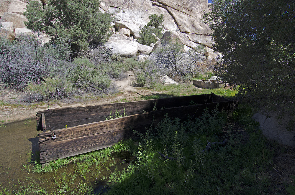 Wooden water trough near the Dam.