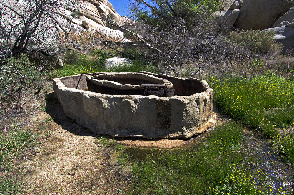 Stone and cement watering trough. A pipe brought water here from the Dam.