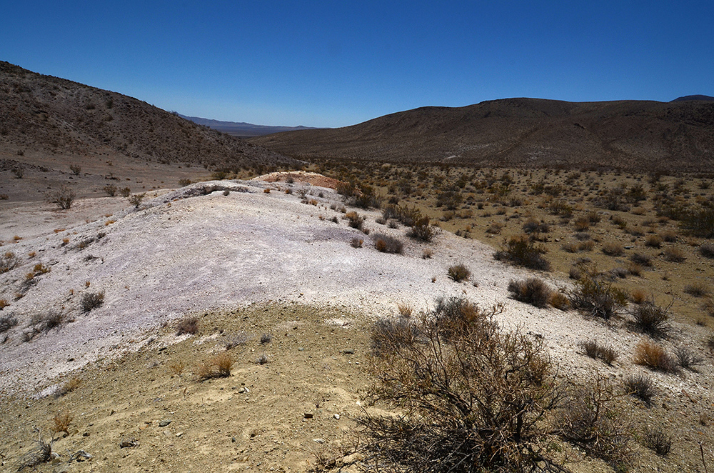 These colorful sand hills intrigued me, so I climbed atop and saw something on the other side that needed investigation.