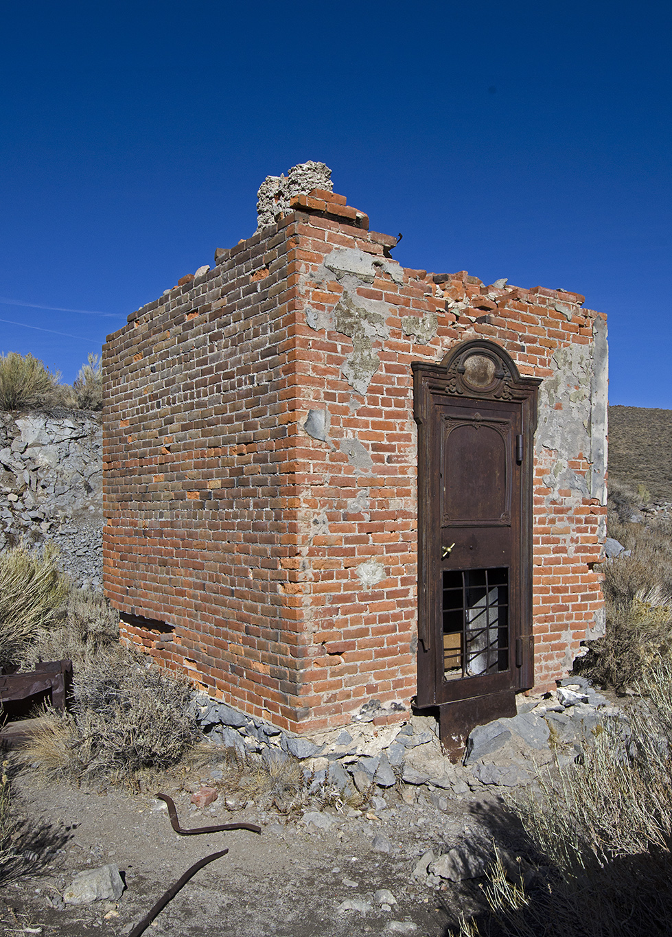 The Bodie Bank once stood here. James Cain bought it from E.L. Benedict in 1890. It escaped the fire of 1892 but was destroyed in the fire of 1932. This is the remains of the vault.