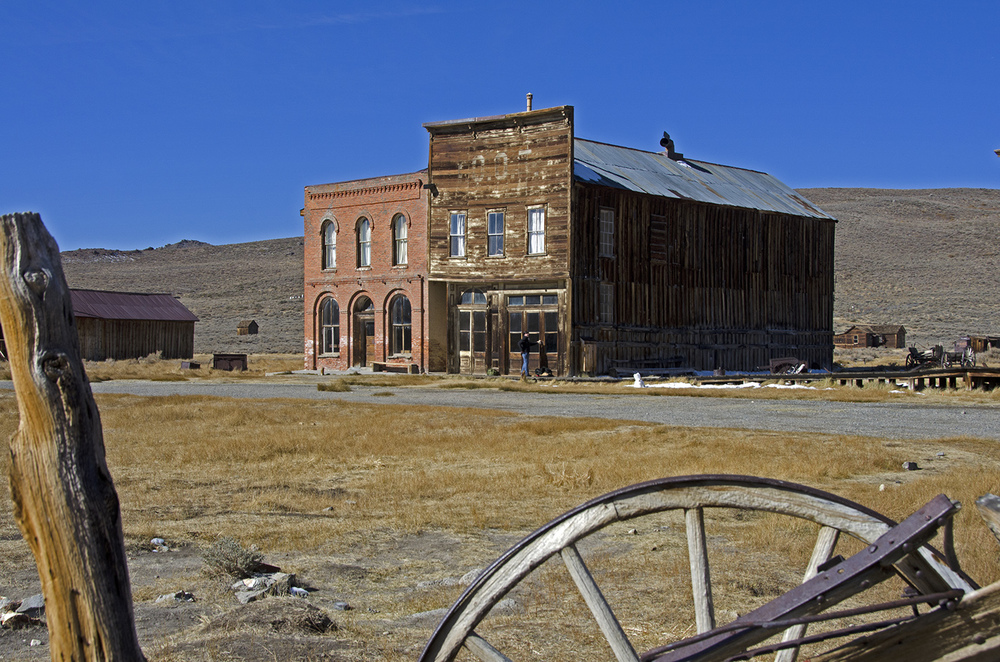 The Post Office building on the left and the Bodie Odd Fellows Lodge on the right. The post office moved here in 1879. The Odd Fellows building was constructed by H. Ward, who ran his undertaking business on the first floor.