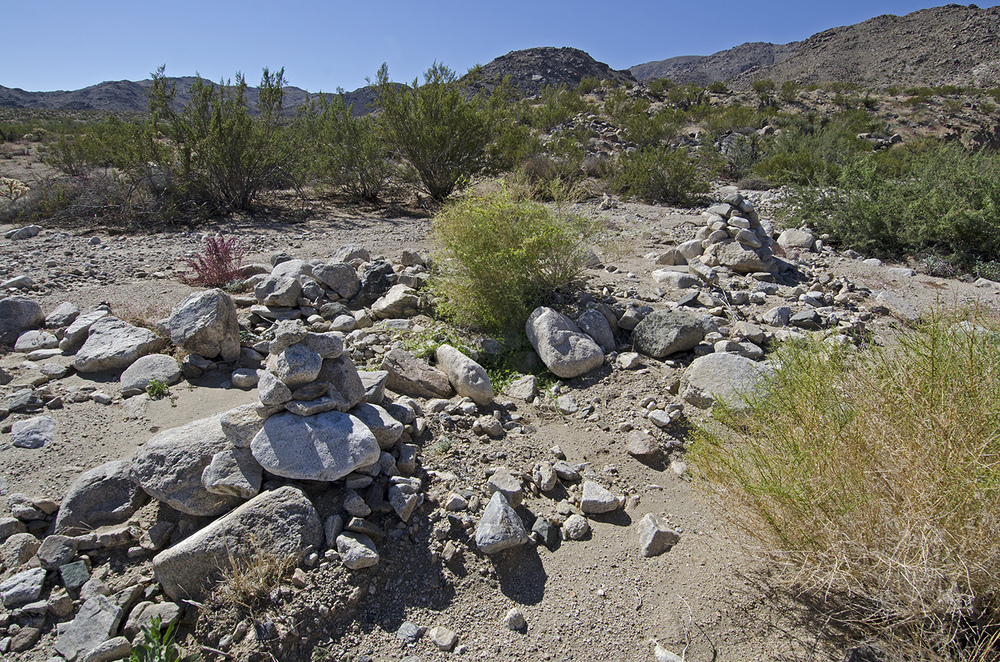 These two large rock cairns mark the spot when it's time to leave the wash on the LEFT hand side. N34.06572  W116.04074