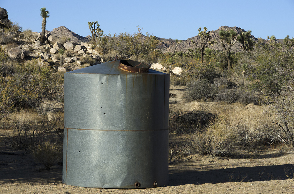 West of the corral I found this huge water tank and some pipes.