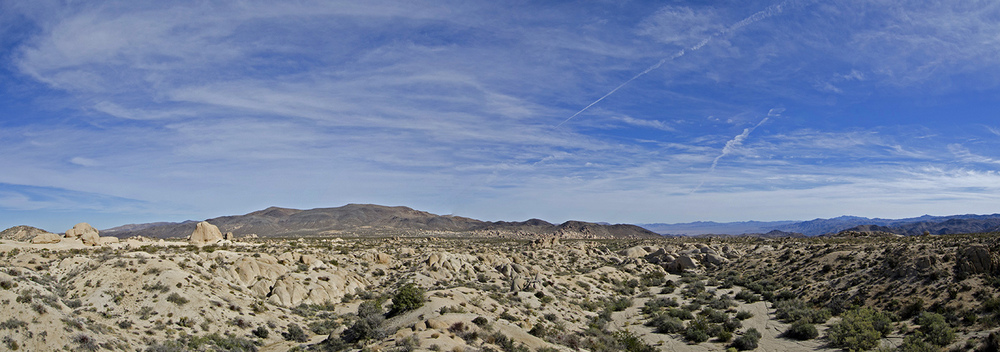 Panorama of the view from the quartz outcropping back towards the parking area, and Belle and White Tank campground areas.