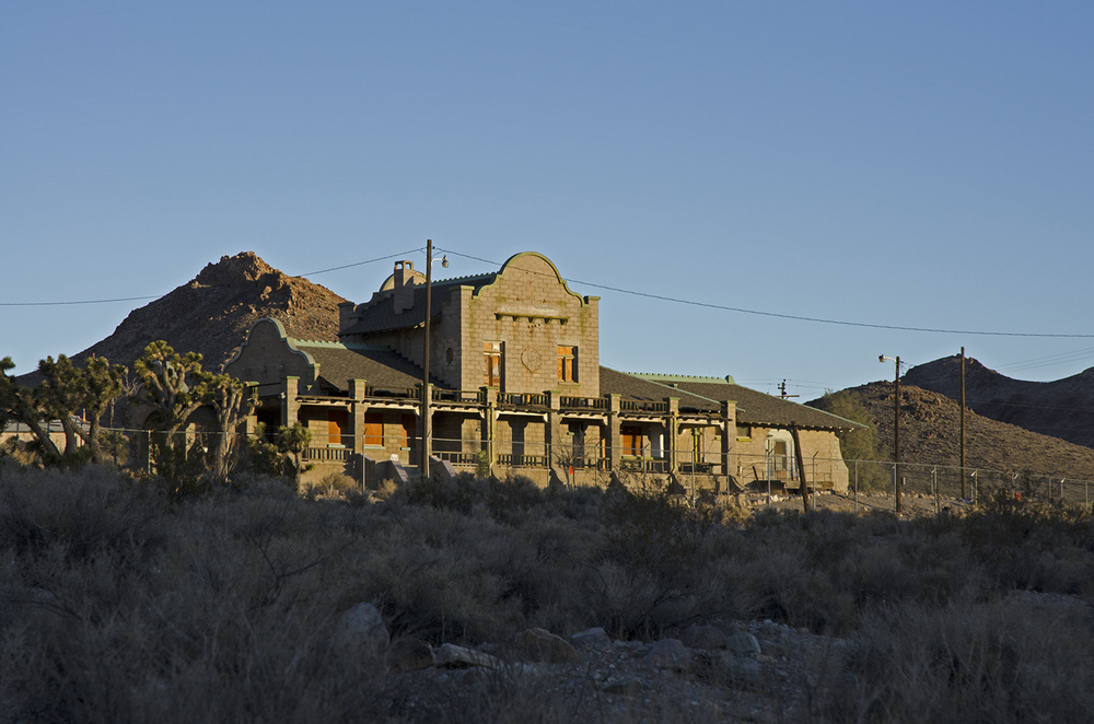 The Las Vegas and Tonopah Railroad Depot building was completed in 1908. Three different rail lines serviced Rhyolite during its heyday. The iron rails were removed in 1917 for use in WWI. Over the years this building served as a home, a barracks, the Ghost Casino, a gift shop and even a church. It is currently owned by the BLM.