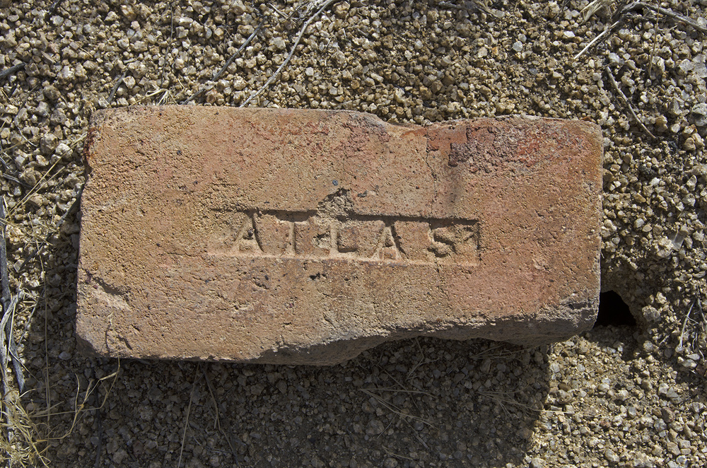 One of the many bricks at the site. Could have come from the Atlas Fire Brick Company of Los Angeles.