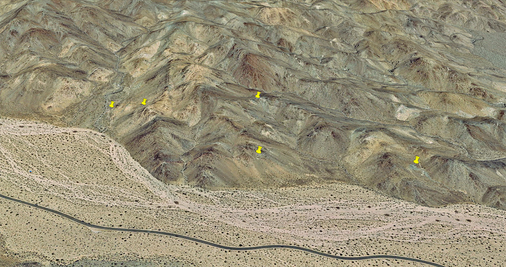 Yellow Pins mark a few of the mining sites at this location:  33.935155° -115.952025°