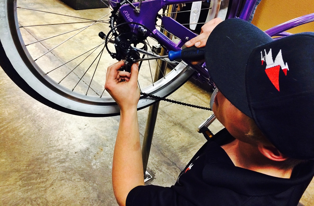 John fixes a bike