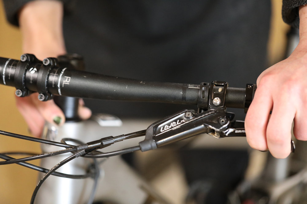 With your left hand holding the front brake as you rock the bike back and forth, you can feel for play between the headset and frame with your right hand.