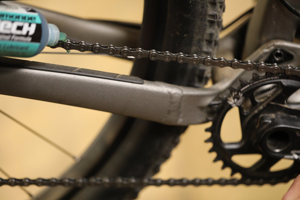 To apply chain lube, backpedal while applying a thin stream to one revolution of chain.