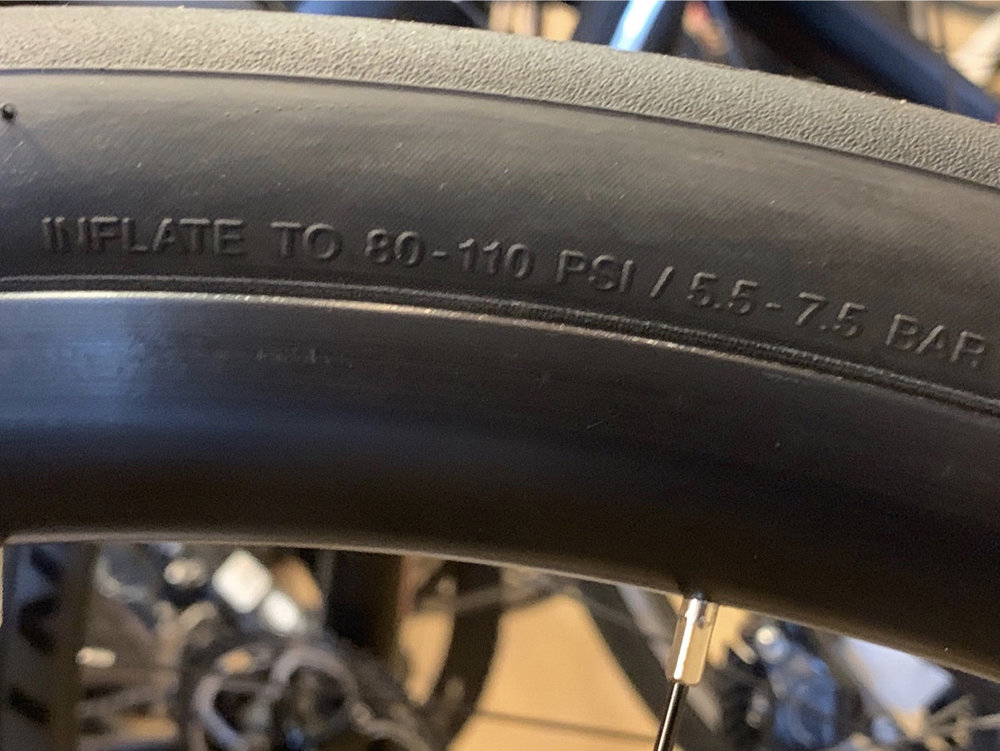 For this road tire, the acceptable pressure range is 80-110 psi. It's helpful to have a pump with a dial at home.