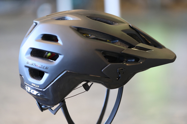 Bontrager Rally MIPS > - The Rally MIPS mountain bike helmet raises the bar in comfort and protection. Ride all day on the toughest trails knowing you're well protected with extended coverage and kept cool with ample vents. The adjustable visor makes this helmet perfectly compatible with goggles. Internal-recessed channels maximize ventilation and minimize hydration-reducing sweat. Available in a variety of colorways.