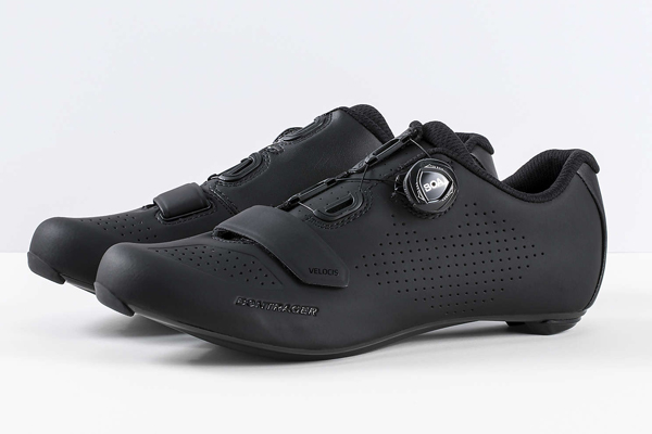 """Bontrager Velocis Road Shoe > - We've all felt it: """"I've had miles of unforgettable smiles in these well-worn shoes; it's time for new pumps!"""" Enter Bontrager's Velocis: kicks designed to be stiff and durable yet remarkably comfortable. Their agreeable feel is owed, in-part, to """"perforated uppers."""" This feature keeps your feet warm and dry in rain, but these soulplates won't disappoint on long and hot rides. The Velocis will give committed roadies and dirt-loving cross-country riders opulent adventures, in all elements."""