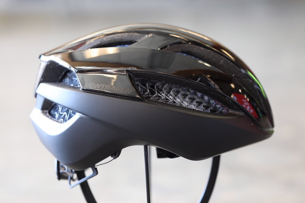 """< Bontrager Specter WaveCel Helmet - Bontrager just dropped the mic. Trek engineers worked with academic and medical research teams to design the WaveCel-integrated helmet. This 3D, cellular material """"flexes, crumples, and glides"""" reducing the lateral and rotational impact forces you experience in a crash. Specter WaveCel is a lightweight, breathable cycling helmet appropriate for all types of riding. Three other models also available: XXX (road), Blaze (mountain) and Charge (commuter). Come on in and check out this revolutionary technology yourself. After all… you only get one brain."""